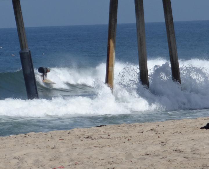 surfing-through-the-pier