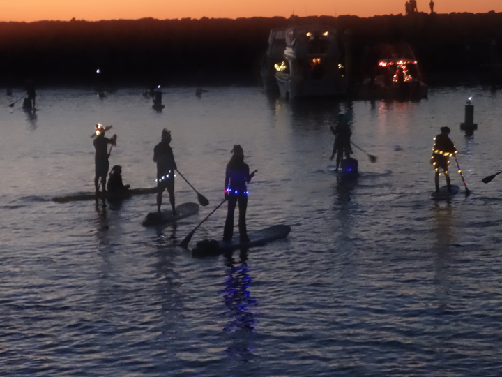 standup-paddleboarders-boat-parade