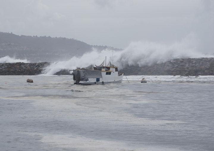 boat-in-harbor-water-cascading-beak-wall
