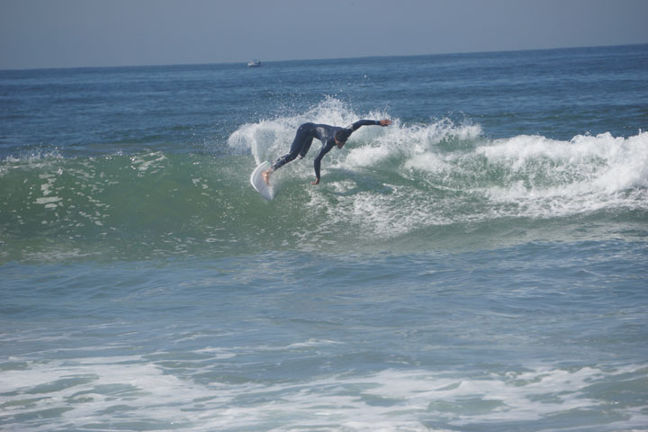 surfer-twisting-away-hermosa
