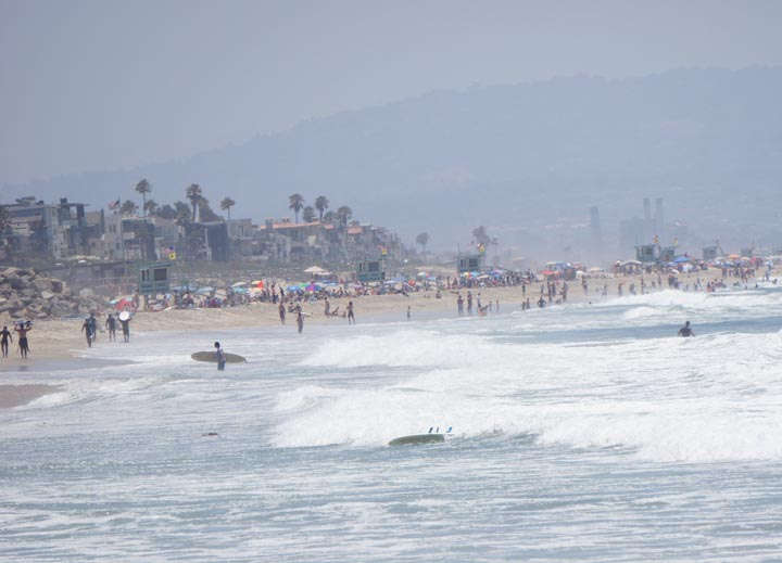 El Porto on a sunny summer day lots of surfers in the water