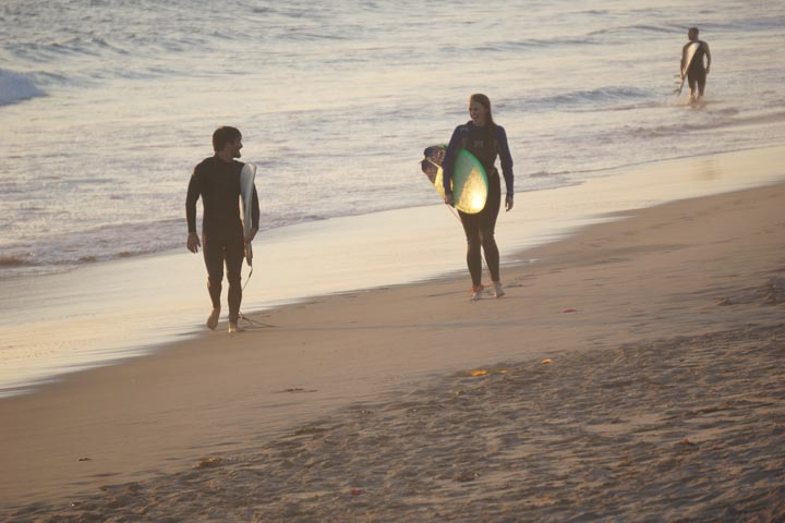 el-porto-surfers-exiting-water-sunset