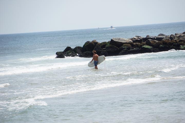 jersey-surfer-by-rocks-ocean-grove
