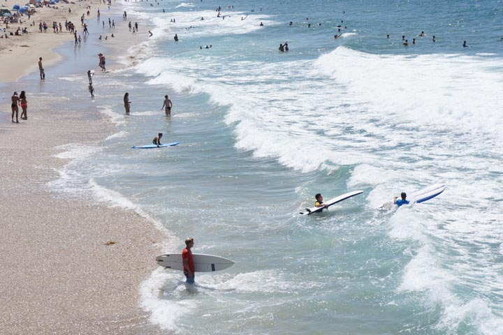 Surfers catch their last rides of summer in Hermosa on Labor Day