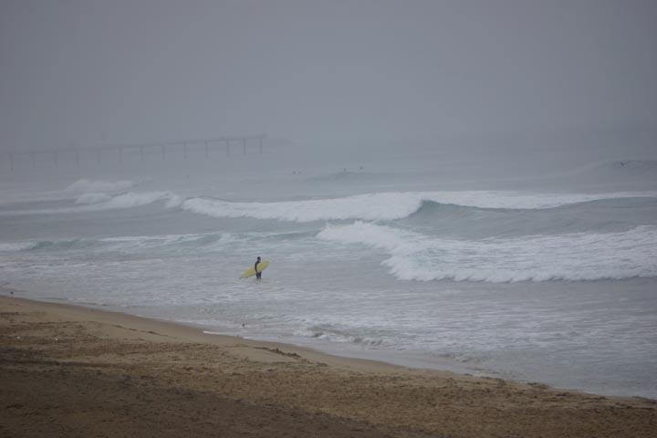 surfer-south-manhattan-pier-rainy-day