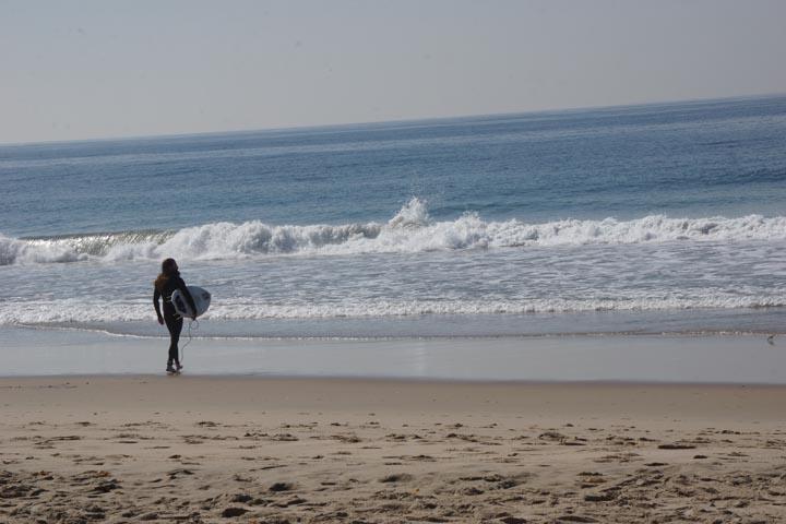 bearded-surfer-walking-toward-waves-hermosa