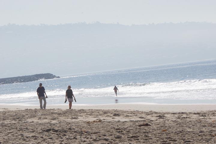 couple-walking-beach-hermosa-sunny