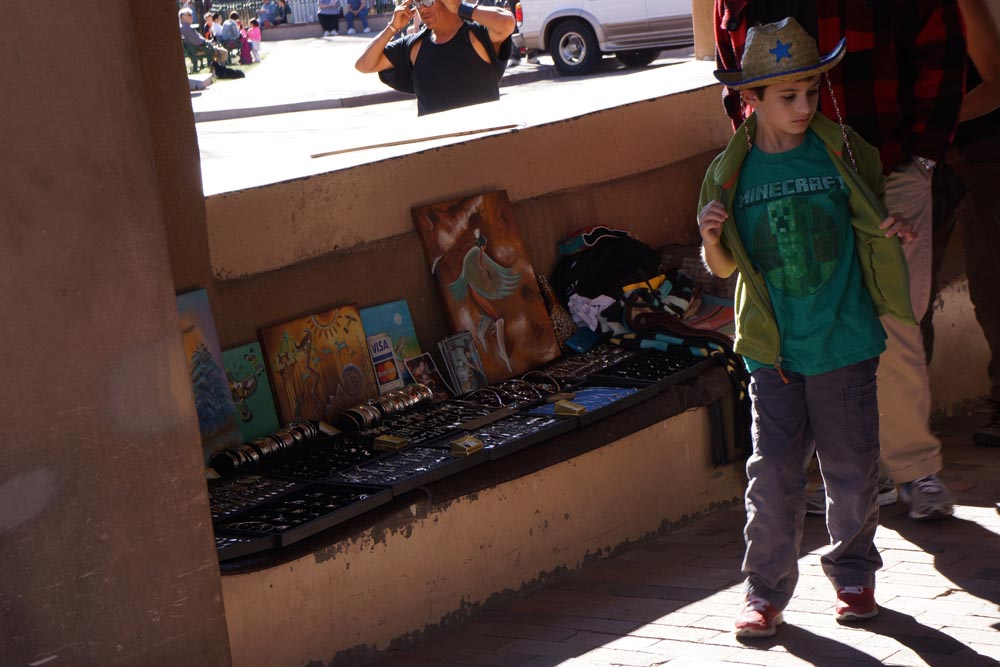 little-boy-walking-by-native-jewelry-palace-governors-santa-fe