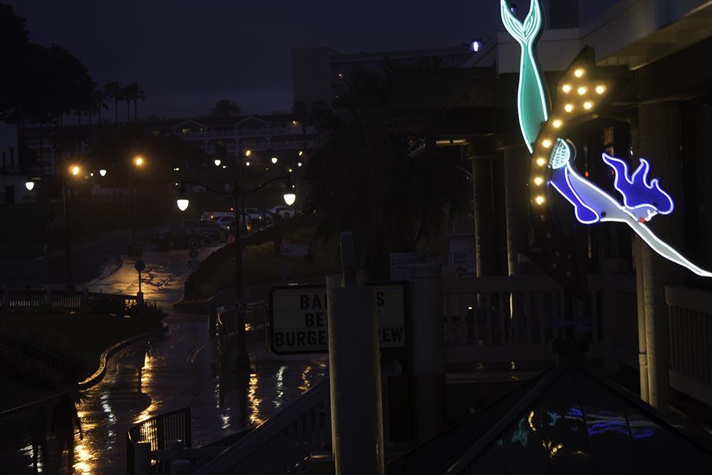 neon-mermaid-rainy-night-redondo-pier