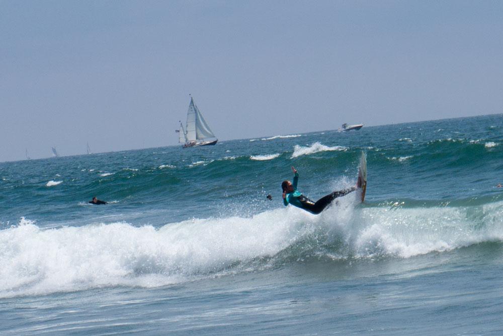 surfer-levitating-venice-boats