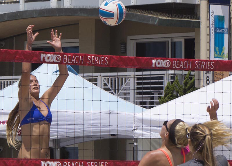 reaching-net-beach-volleyball-hermosa