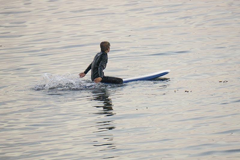 capitola-surfer-paddling