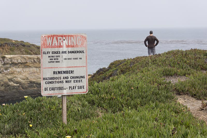 cliff-edge-warning-man-santa-cruz