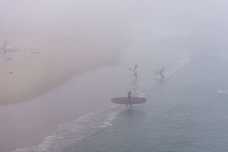 hermosa-surfers-running-heavy-fog-march-morning