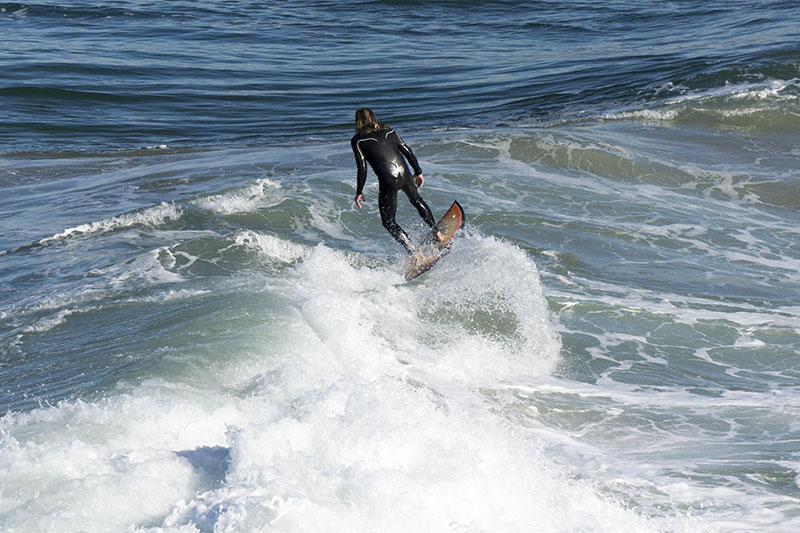 surfer-levitating-mb-pier-march-morning