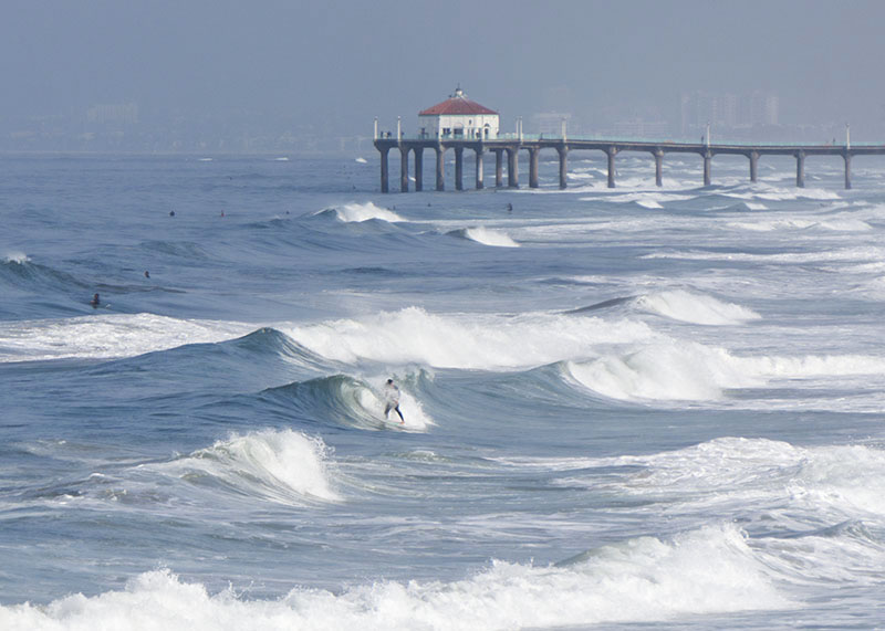hermosa-surfer-bunch-swells-pier-april-morning