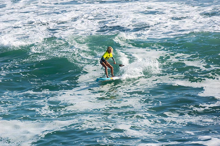 girl-paddleboarder-south-pier-june-hb-competition