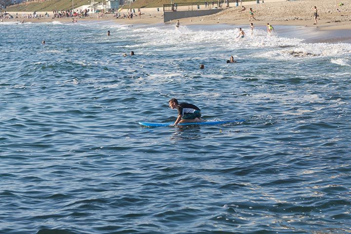 paddling-out-serious-intent-rb-south-pier-july
