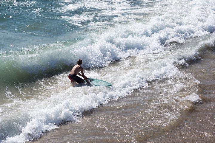 skimboarder-by-hermosa-pier-sunday-july