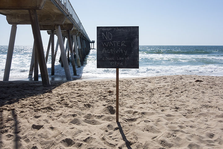 no-water-activity-except-surfing-hermosa-sign-april
